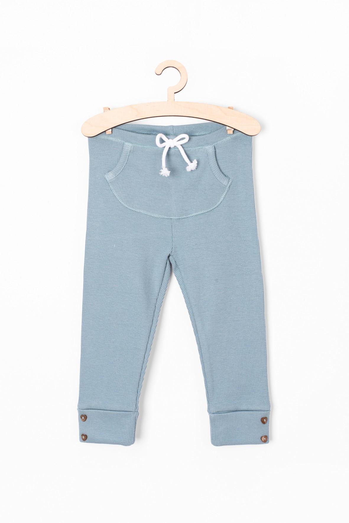 Leginsy dziewczęce niebieskie z kieszenią z przodu