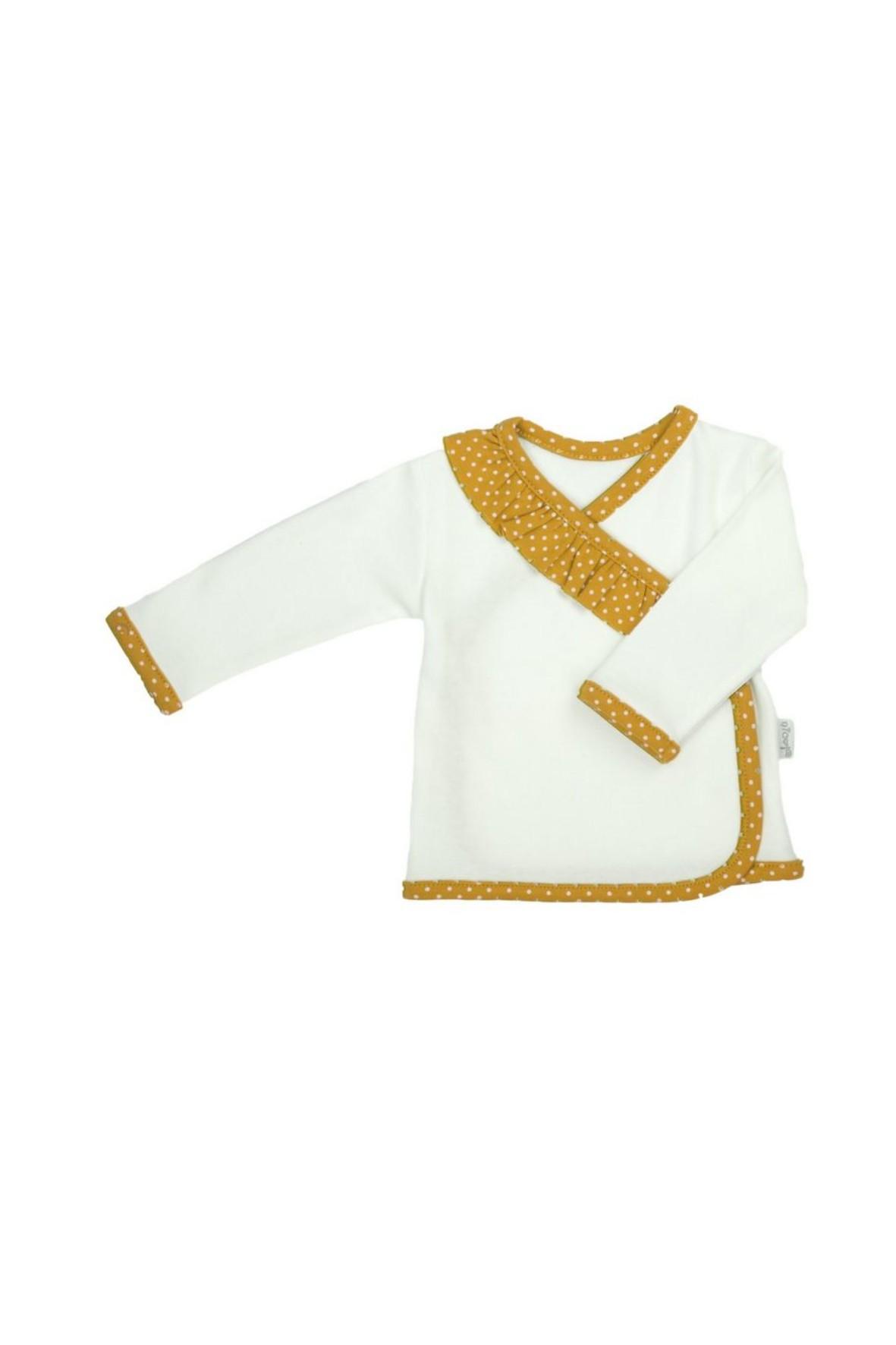 Kopertowa bluzka w kremowym kolorze z ozdobną falbanką