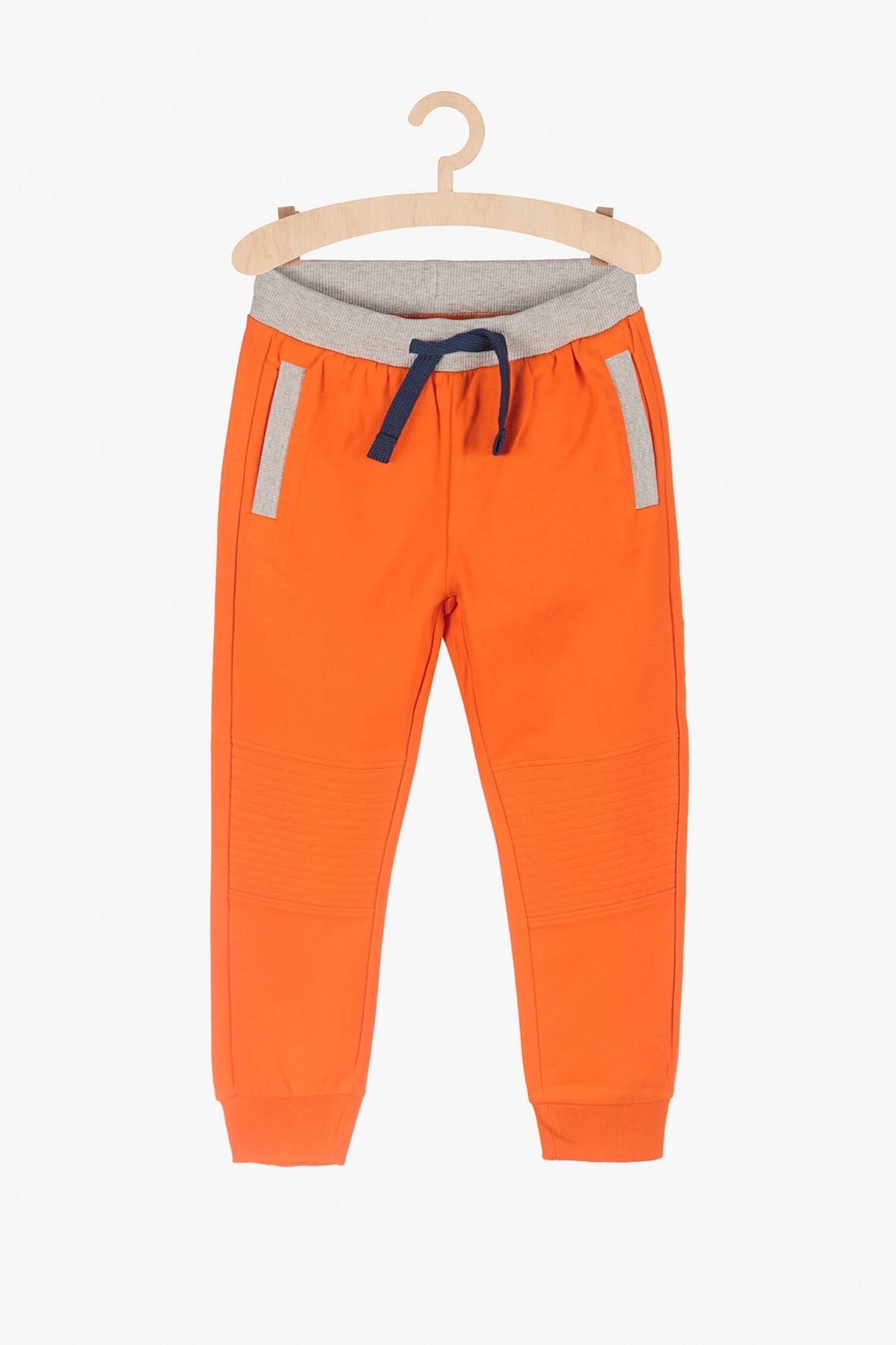 Spodnie dresowe chłopięce - pomarańczowe