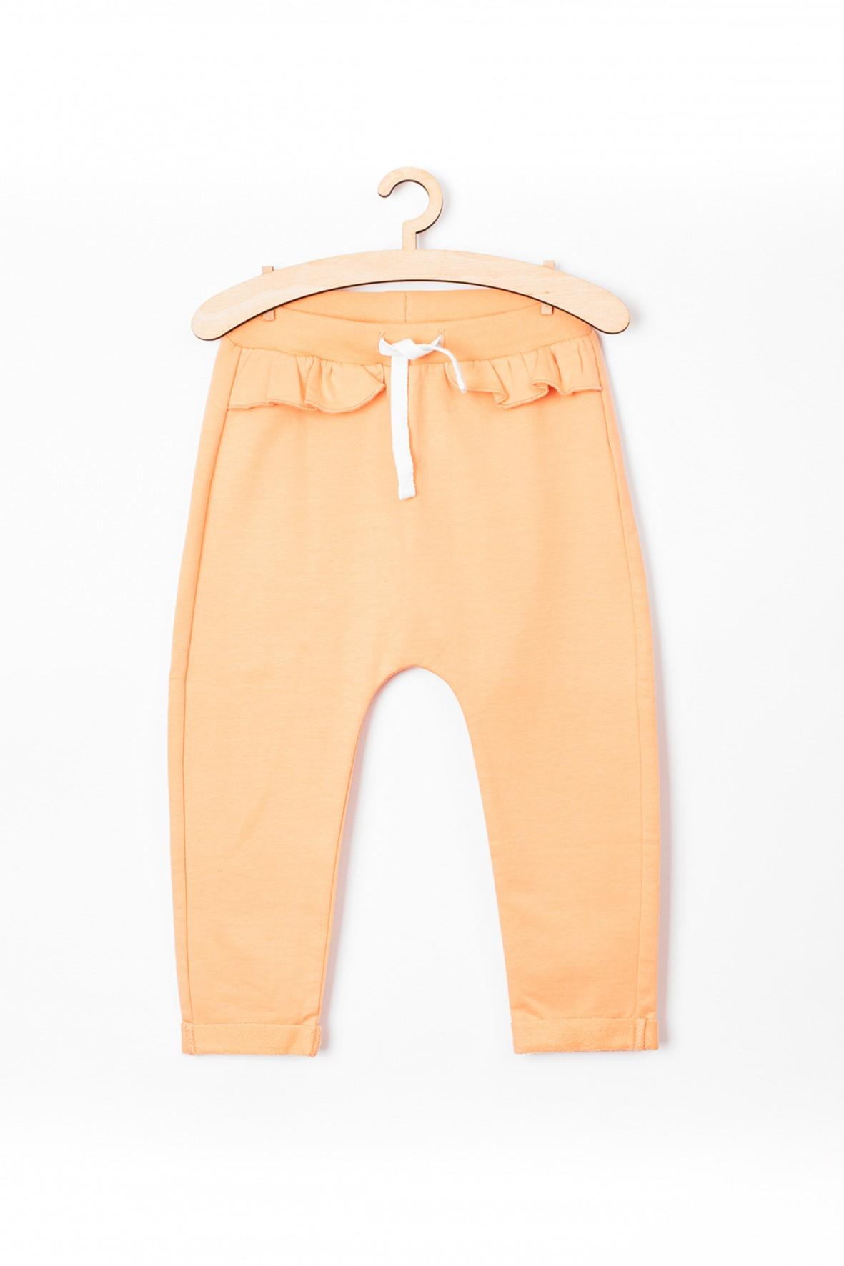 Spodnie niemowlęce dresowe z falbanką