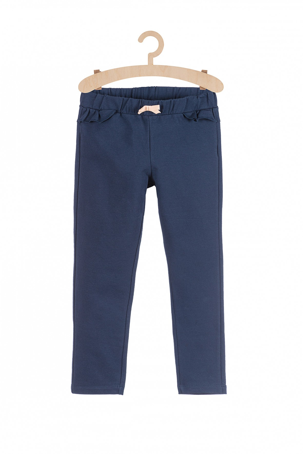 Granatowe spodnie dresowe z ozdobną falbanką
