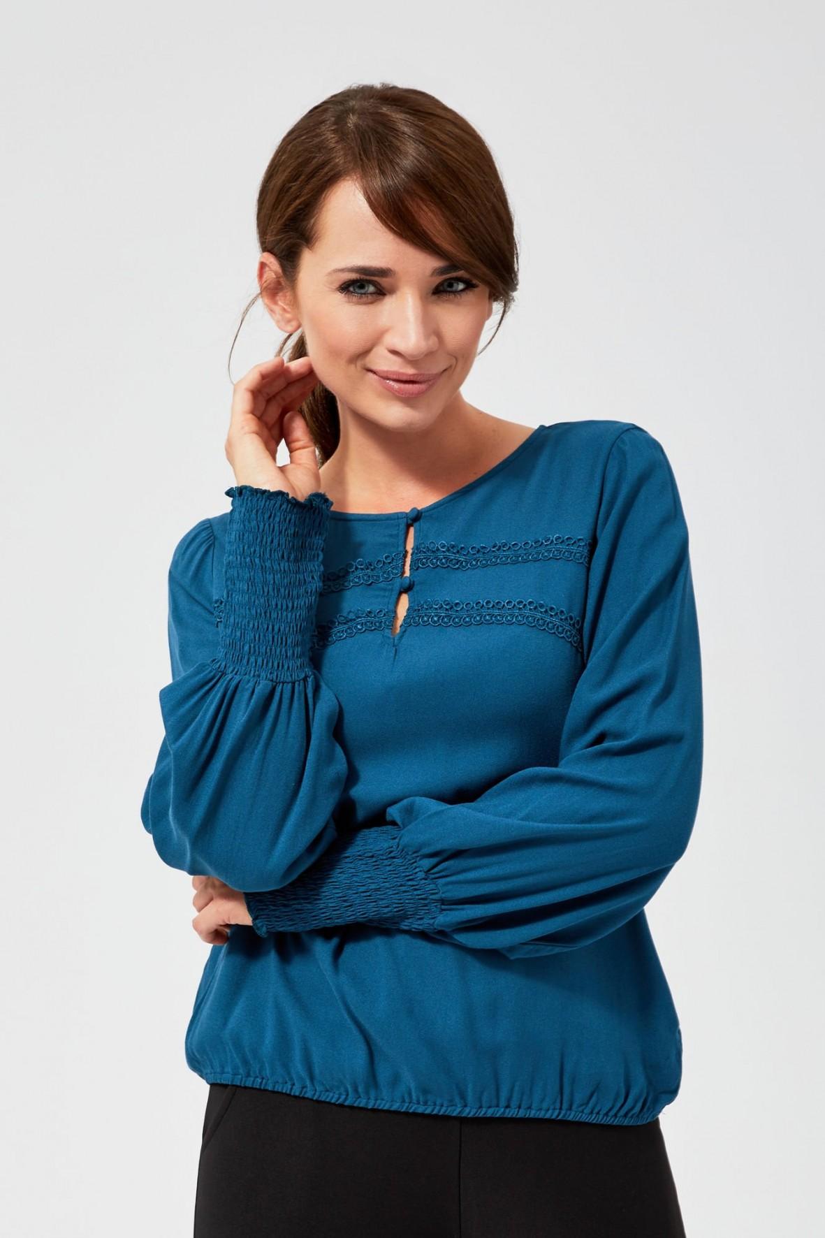 Turkusowa bluzka damska ze ściągaczami