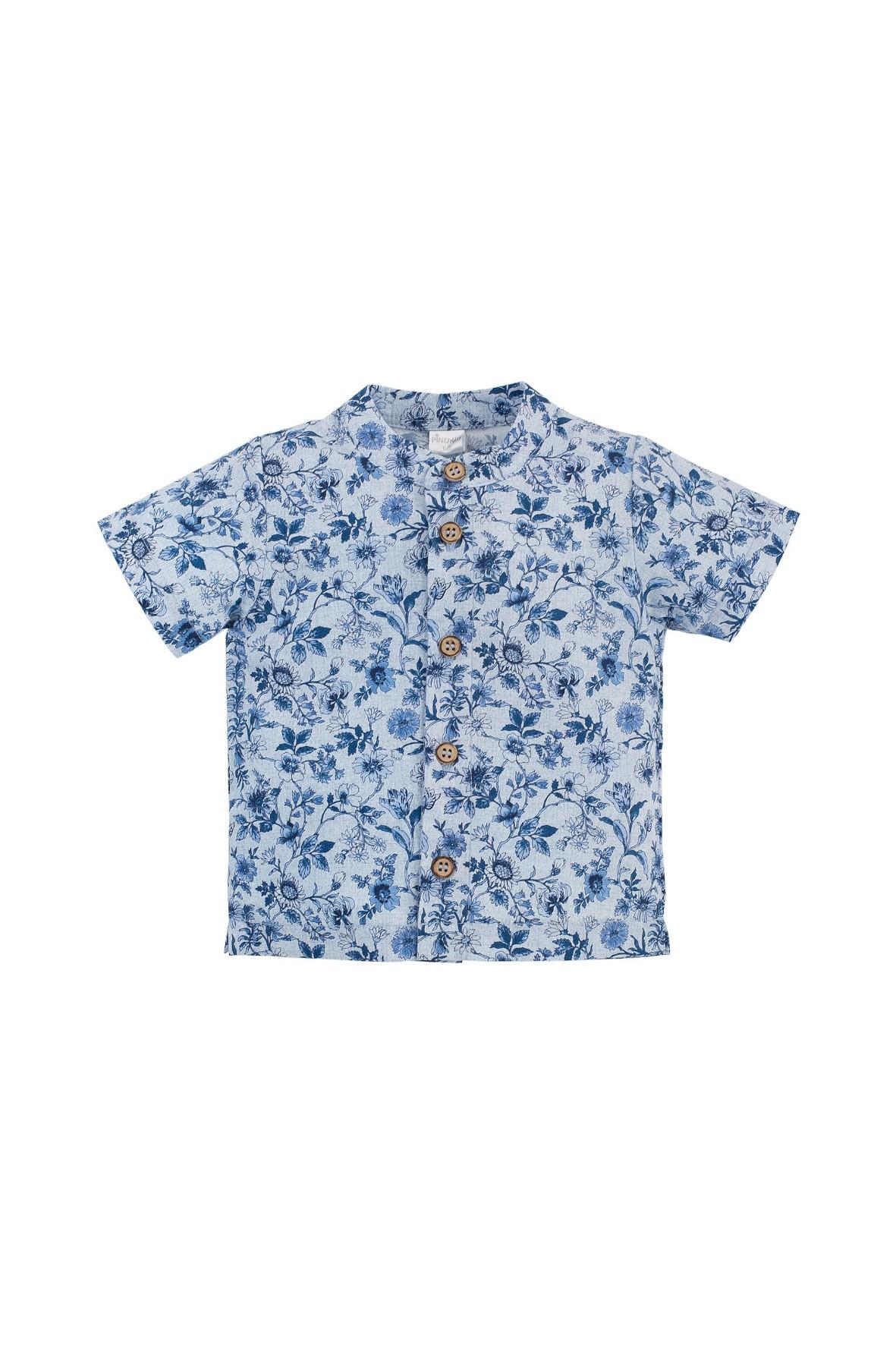 Bawełniana niebieska koszula chłopięca na krótki rękaw w niebieskie kwiatki
