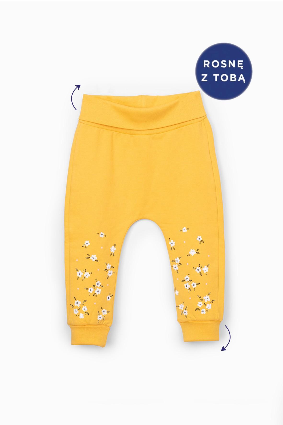 Spodnie dresowe z kwiatkami - żółte