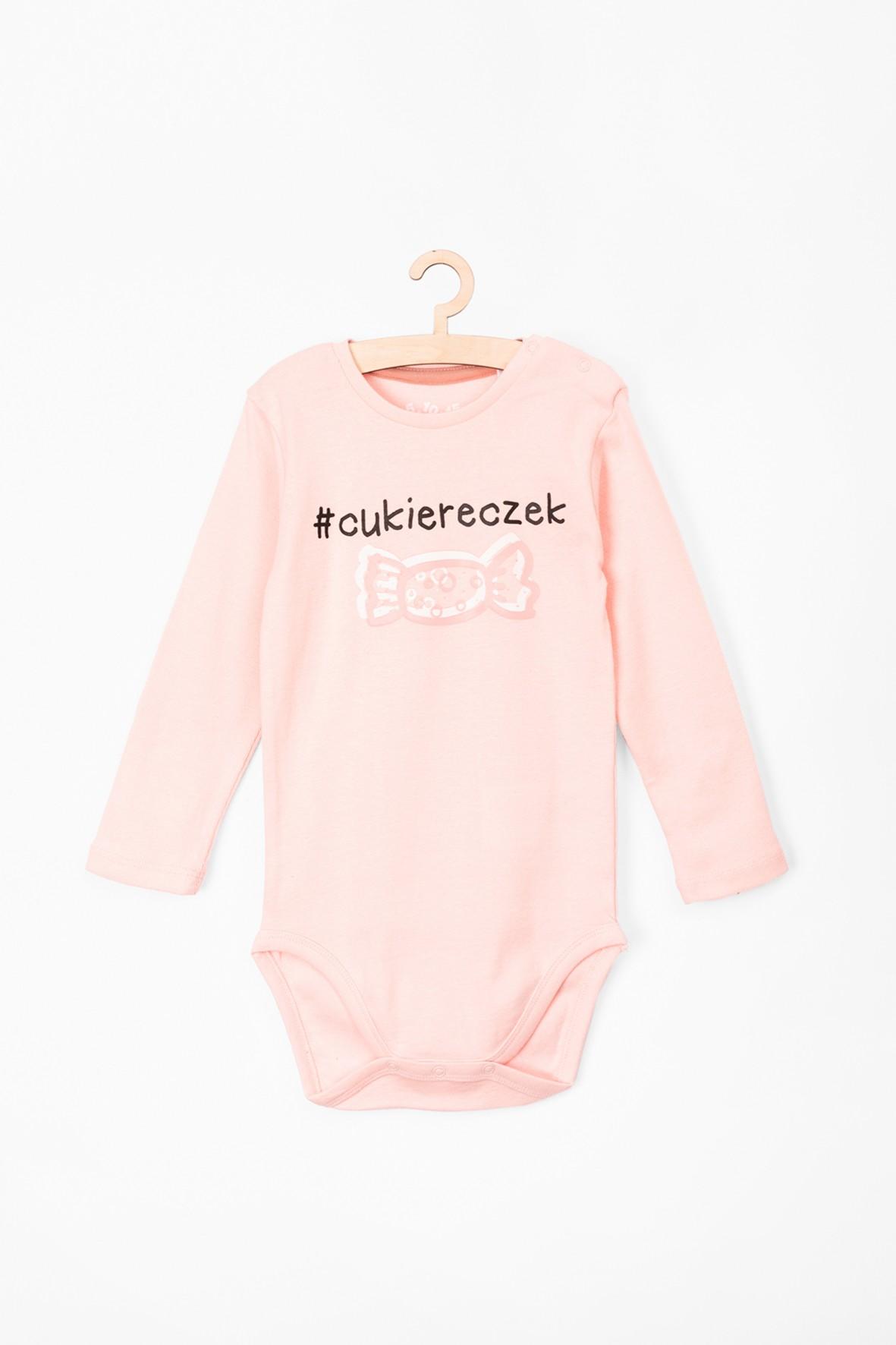 Body bawełniane dla niemowlaka różowe z napisem Cukiereczek
