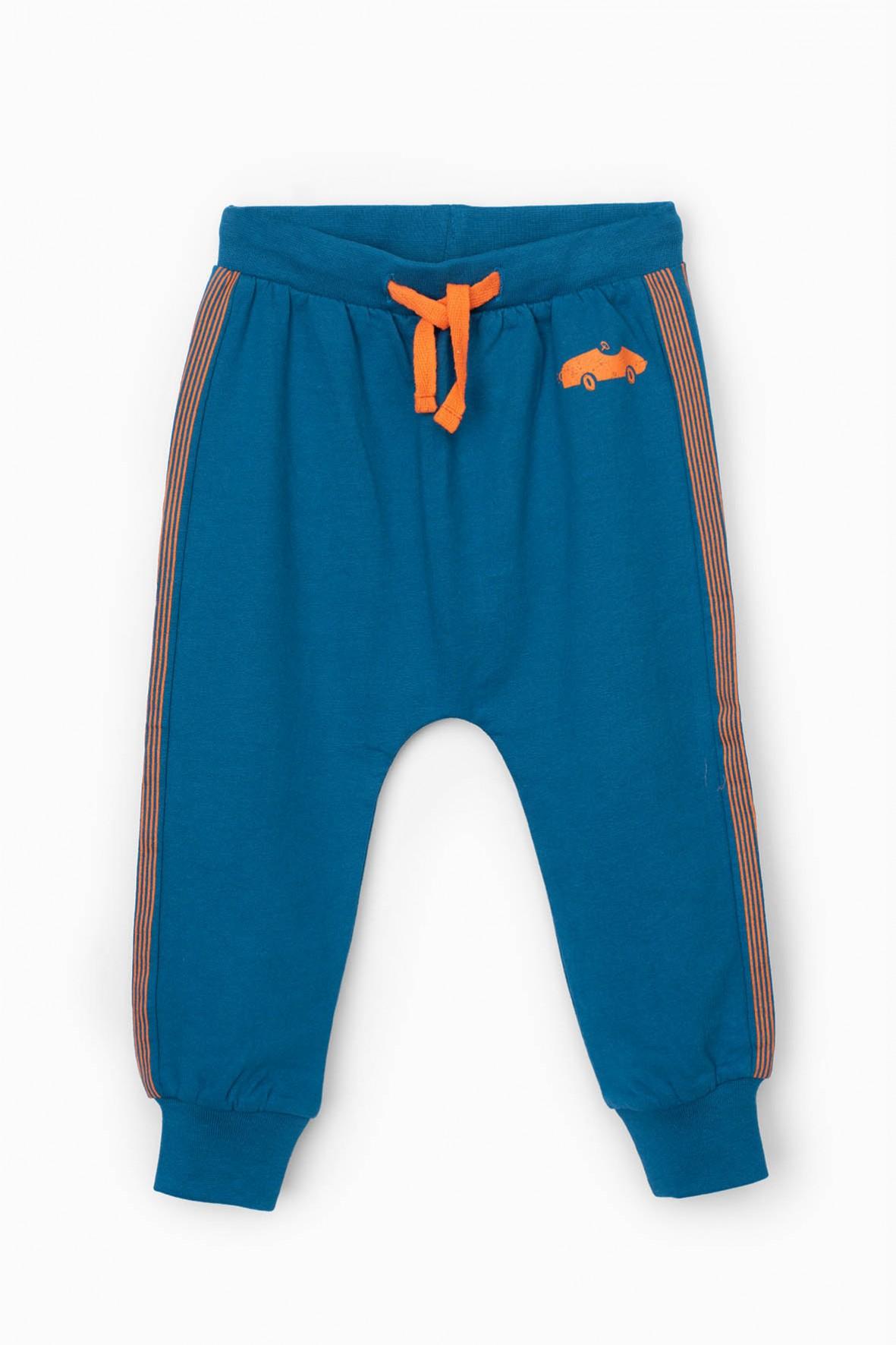 Niebieskie spodnie dresowe niemowlęce z pomarańczowymi wstawkami