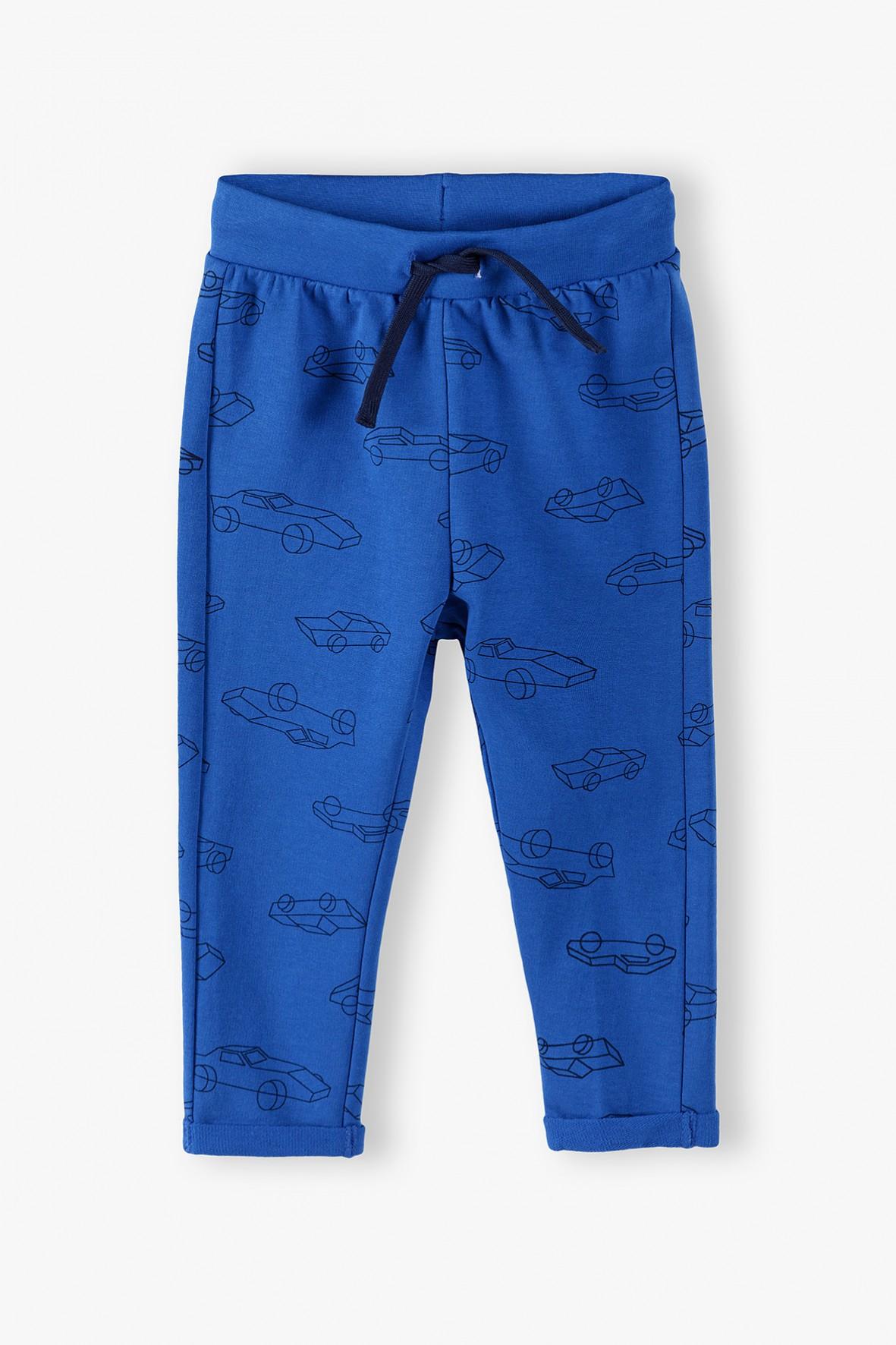 Bawełniane spodnie dresowe niebieskie w autka
