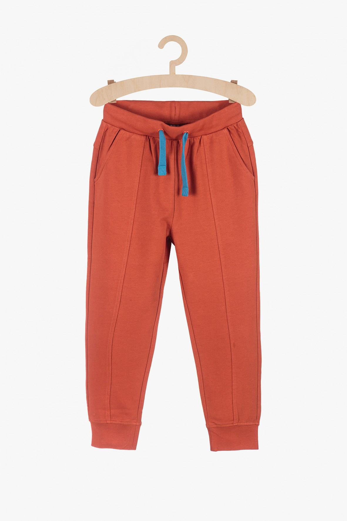 Spodnie dresowe dla chłopca - pomarańczowe