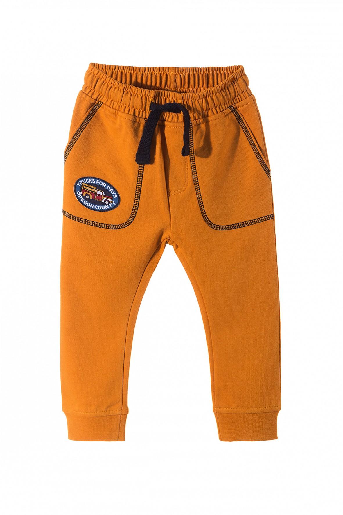 520cdd54e85b6 Spodnie dresowe dla chłopca z kieszeniami- nogawki zakończone ...