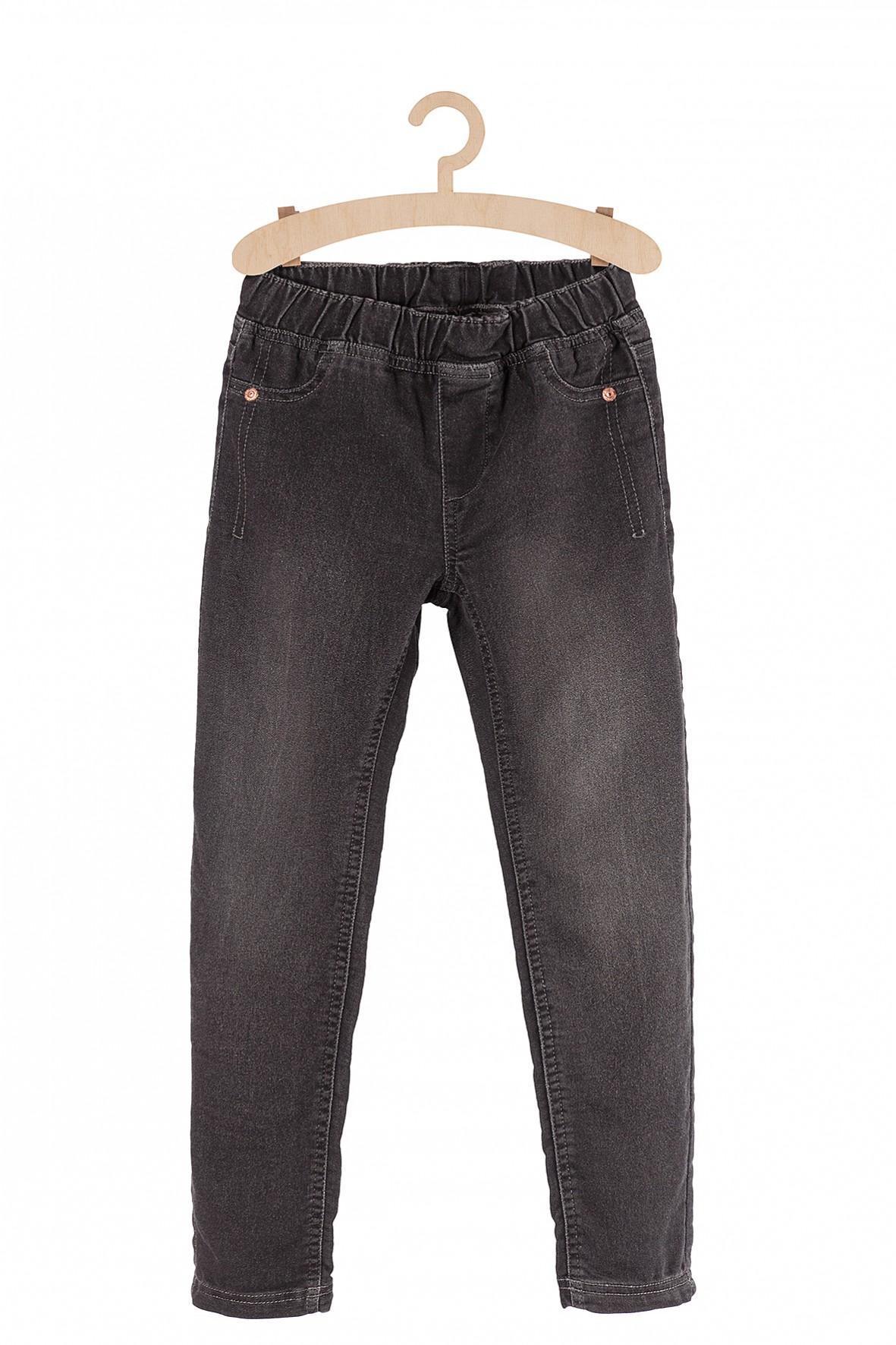 Czarne spodnie dziewczęce z efektem sprania