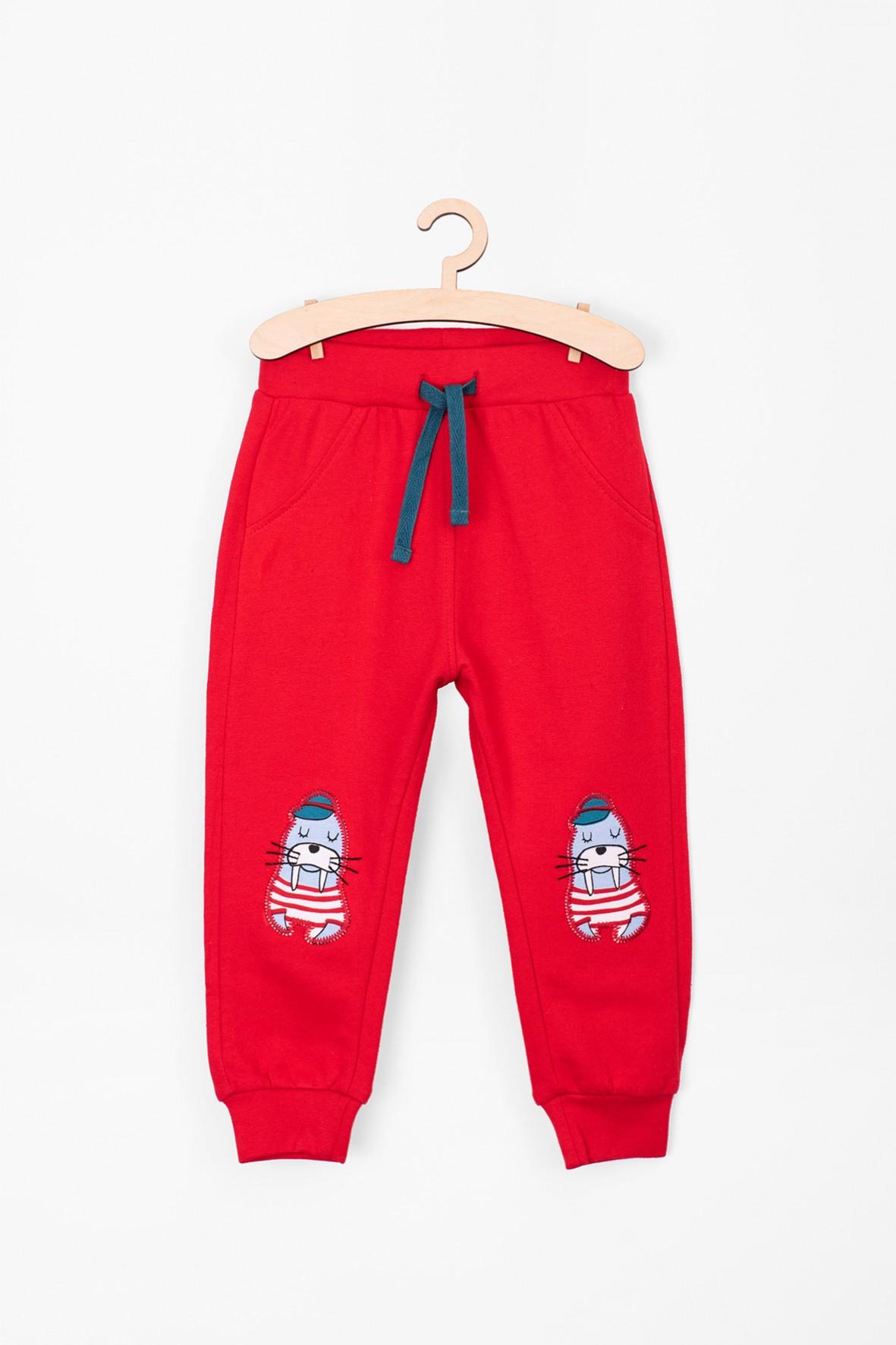 Spodnie dresowe dla niemowlaka- czerwone z morsem