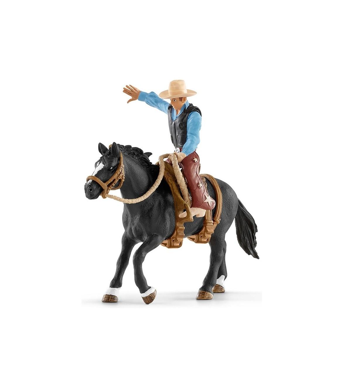 Kowboj siodłający dzikiego konia