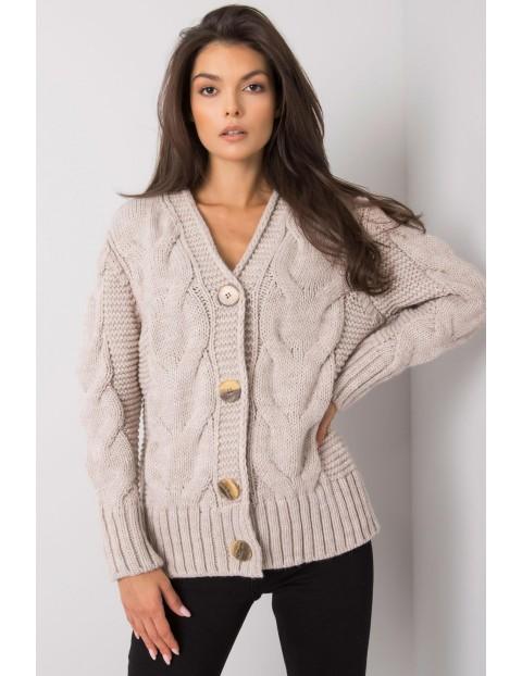 Beżowy sweter rozpinany z ozdobnym splotem