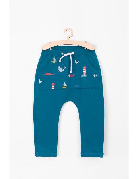 Spodnie dresowe z kolorową kieszenią