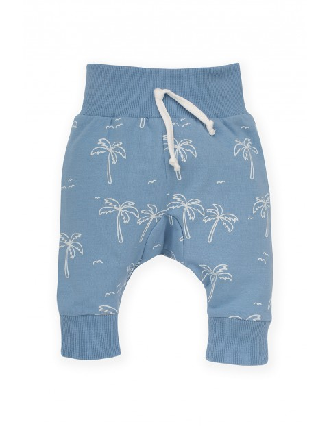 Dresowe spodnie niemowlęce niebieskie w palmy