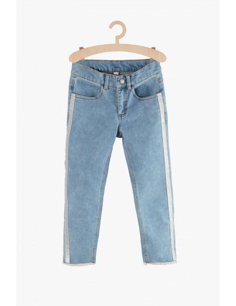 Spodnie jeansowe dziewczęce że srebrnymi lampasami