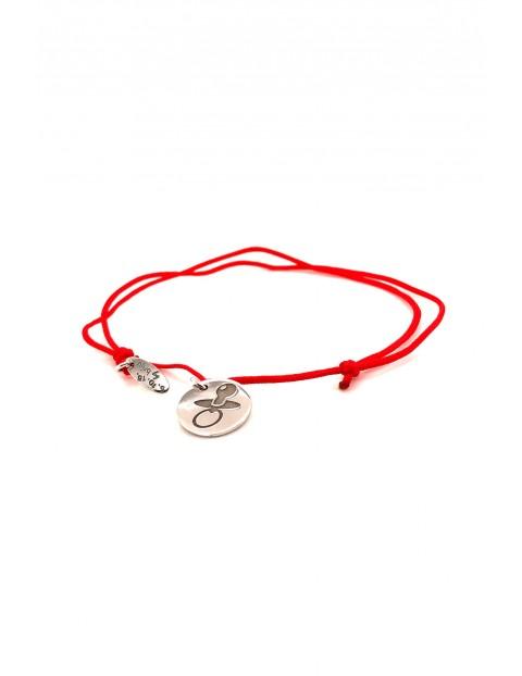 Narodziny- bransoletka srebrny Smoczek - czerwony sznurek