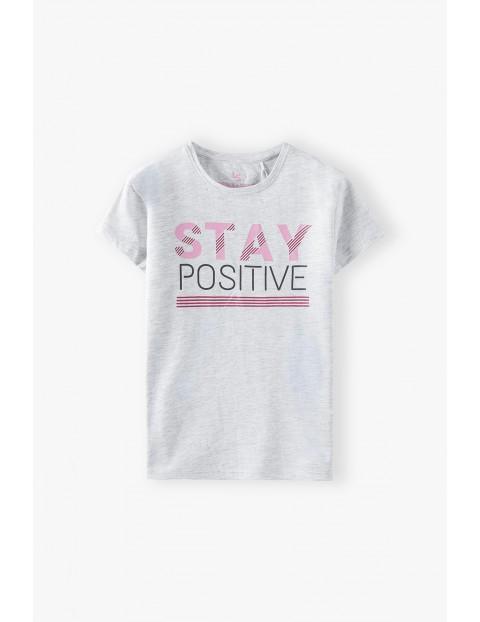 Beżowy t-shirt dziewczęcy z napisem Stay Positive