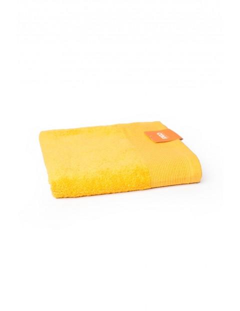 Bawełniany ręcznik w kolorze żółtym o wymiarach 50x100 cm