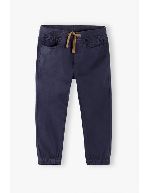 Spodnie - Joggery chłopięce w kolorze szarym