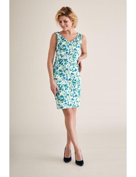 Dopasowana sukienka w kwiaty na lato midi