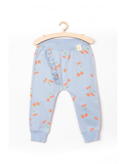 Spodnie niemowlęce dresowe- niebieskie w owoce