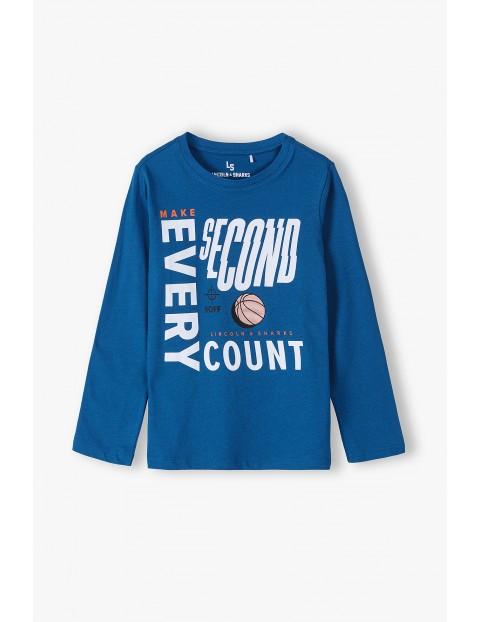 Bawełniana bluzka chłopięca z długim rękawem - niebieska z nadrukami