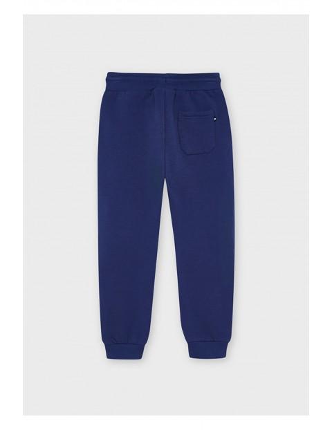 Długie chłopięce spodnie  dresowe - granatowe