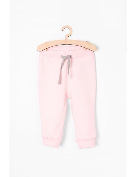 Różowe spodnie dresowe dla niemowlaka - Organic Cotton