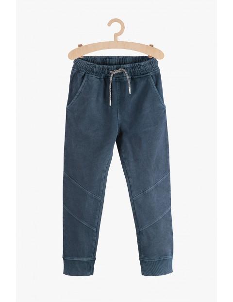 Spodnie chłopięce dresowe- granatowe z kieszeniami