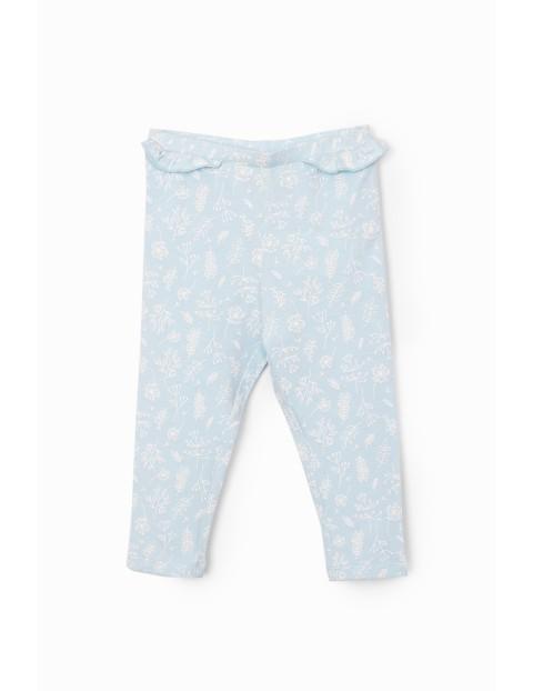 Spodnie dziewczęce dresowe w kwiatki - ozdobna falbanka