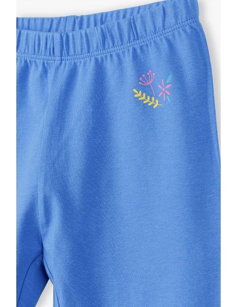 Niebieskie legginsy dziewczęce w kolorowe wzorki