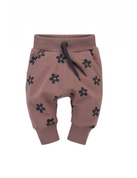 Spodnie dziewczęce dresowe pumpy różowe w kwiatki