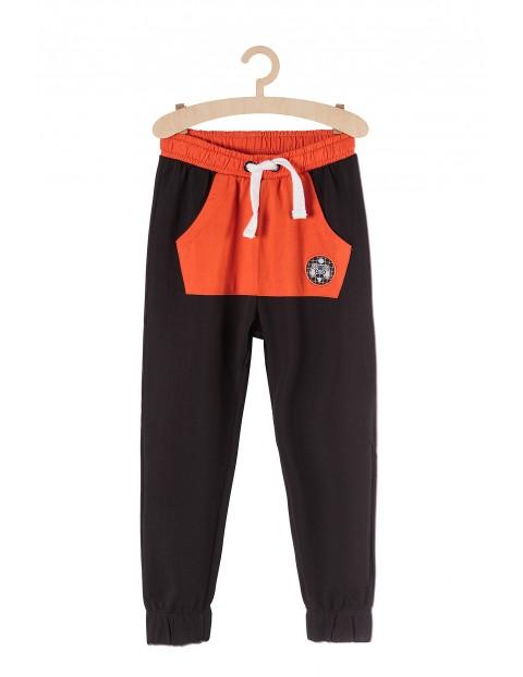 Spodnie chłopięce szare z pomarańczową kieszenią