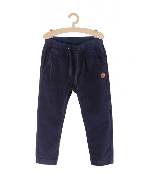 Spodnie chłopięce granatowe z reniferem