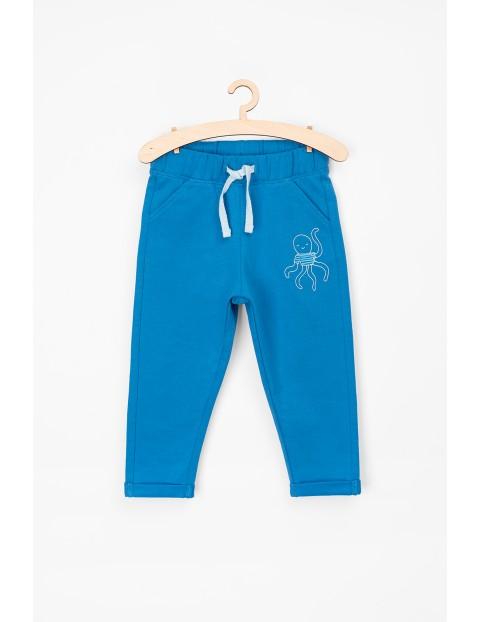 Spodnie bawełniane dla niemowlaka-niebieskie z ośmiornicą