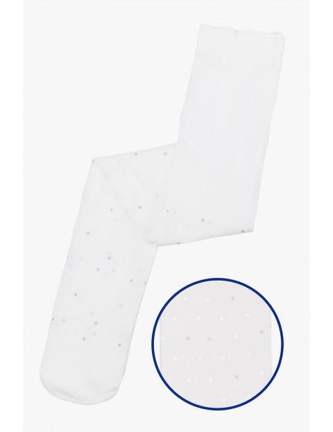 Białe cienkie rajstopki w srebrne kropki