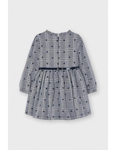 Sukienka w groszki z rozkloszowanym dołem - granatowa