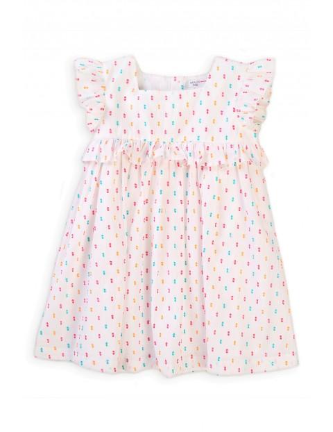 Bawełniana sukienka niemowlęca biała w kolorowe wzorki