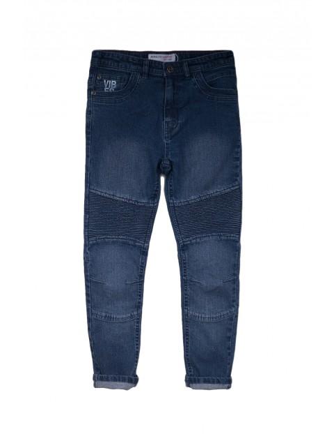 Spodnie chłopięce jeansowe z ozdobnym nadrukiem