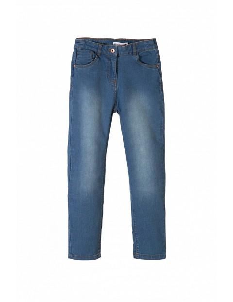 Niebieskie spodnie jeansowe dziewczęce