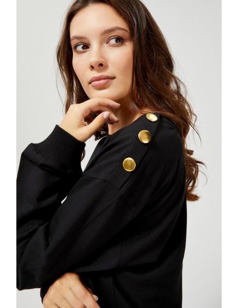 Czarna bluza damska z ozdobnymi guzikami na ramieniu