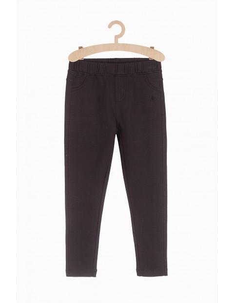 Czarne dzianinowe spodnie dziewczęce z kieszeniami