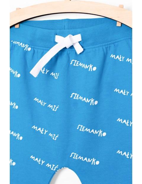 Spodnie dresowe dla niemowlaka- niebieskie z napisem Siemanko