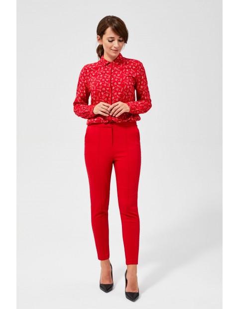Spodnie damskie z przeszyciami i ozdobnymi lamówkami- czerwone