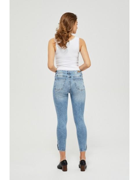Jeansy skinny z guzikami niebieskie