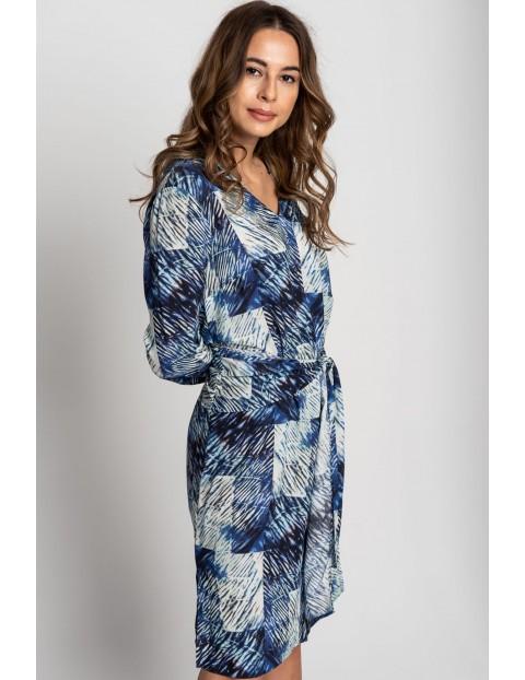 Niebieska sukienka na długi rękaw z ozdobnym wiązaniem