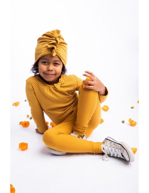 Leginsy dziewczęce w musztardowym kolorze