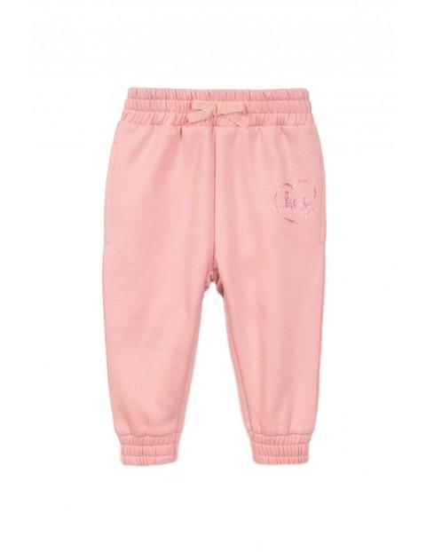Spodnie dresowe dziewczęce różowe rozmiar 92/98