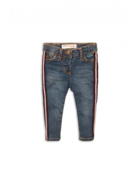 Niebieskie jeansy z różowym lampasem
